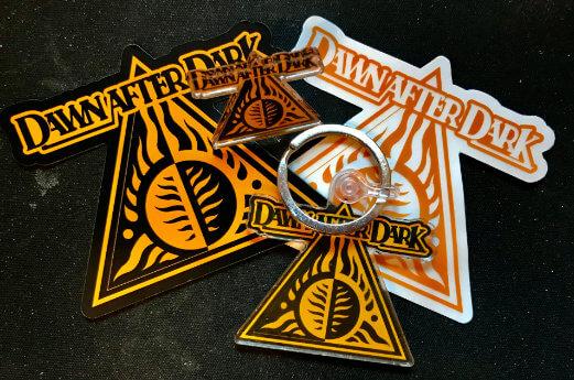 Badge, keyring & sticker pack